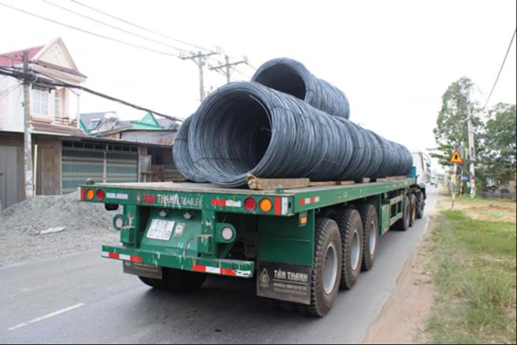 Vận chuyển hàng hoá là sắt thép từ Việt Nam sang Lào